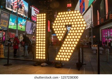 "New York,NY/USA-December 12, 2018 Visitors to Times Square in New York pose in front of the two seven-foot-tall numerals ""1"" and ""9"" in Times Square in New York."