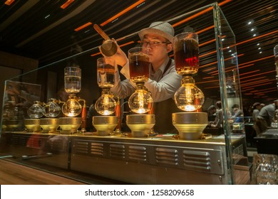 New York,NY/USA-December 14, 2018 A barista prepares siphon coffee to the Starbucks Reserve Roastery in Chelsea in New York on its grand opening day