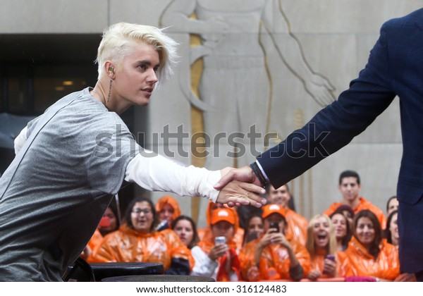 NEW YORK-SEP 10: Singer Justin Bieber shakes hands with Matt Lauer (not pictured) on NBC's 'TODAY Show' at Rockefeller Plaza on September 10, 2015 in New York City.