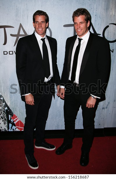 NEW YORK-SEP 28: Cameron (l) and Tyler Winklevoss attend the grand opening of TAO Downtown at the Maritime Hotel on September 28, 2013 in New York City.