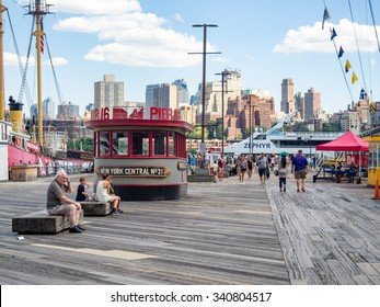 NEW YORK,USA - AUGUST 13,2015 : The South Street Seaport in downtown Manhattan with the Brooklyn skyline on the background