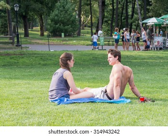 NEW YORK,USA- AUGUST 19,2015 : Young couple spending their free time at Central Park in Manhattan