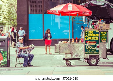 NEW YORK,USA - AUGUST 29 ,2016 : Fast food cart selling hot dogs and other snack in New York City
