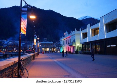 New Zealand - 11 November 2018: Queenstown at night Eichardt's Private Hotel with colorful lights green yellow orange red pink gay celebration Queenstown lakeside sunset