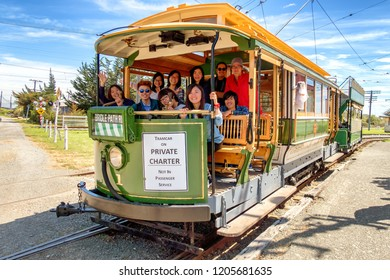 NEW ZEALAND, CHRISTCHURCH, Ferrymead Heritage Park - OCOTBER 2015: A group of unidentified young people rides at the front of a historic tram. Ferrymead park is a popular attraction in Christchurch.
