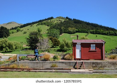 NEW ZEALAND, CHRISTCHURCH, LITTLE RIVER - NOVEMBER 2015: An unidentified woman visits the Little River train station. This train station is a tourist stopover on the way to Akaroa town.
