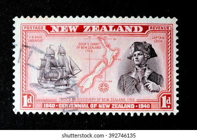 NEW ZEALAND - CIRCA 1940: Mail stamp printed in New Zealand featuring a portrait of Captain Cook, the H.M Bark Endeavour and maritime chart of the islands, circa 1940