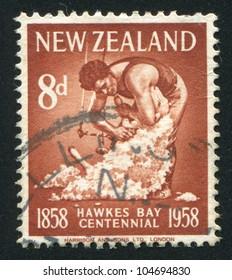 NEW ZEALAND - CIRCA 1958: stamp printed by New Zealand, shows Maori shearing sheep, circa 1958