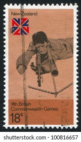 NEW ZEALAND - CIRCA 1974: stamp printed by New Zealand, shows Rifle shooting and British Commonwealth Games Emblem, circa 1974