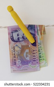 New Zealand dollars hanging on a line.