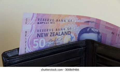 New Zealand Dollars in a Wallet