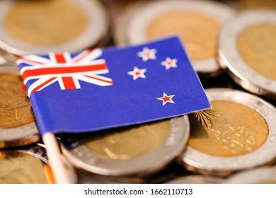 New Zealand flag on coins background : Business and finance concept.