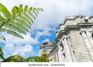 New Zealand Government buildings, House neo classical style House of Parliament with Beehive behind with iconic ponga fern frond one of NZ's emblems.