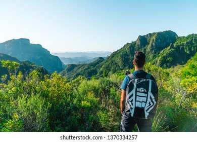 New Zealand - Jan 2019: Man looking out at view of mountains and forest, whilst on Pinnacles Walk Hike. Shot in Coromandal, North Island, NZ. Green and scenic background.