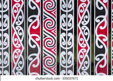New Zealand Maori fens in rotorua with maori art symbols and design like background