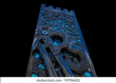New Zealand Maori Waka Carving Isolated On Black Background