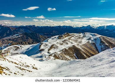 New Zealand mountain panorama and snow ski slopes as seen from Coronet Peak ski resort, Queenstown