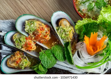 New Zealand Mussel with seafood sauce on decorated dish