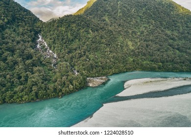 New Zealand nature landscape aerial drone view of Haast River and Roaring Billy Falls waterfall in Mount Aspiring National Park, South Island, New Zealand.