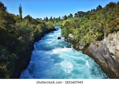 New Zealand, normally 100m wide Waikato River continues like a narrow 15m wide gorge. Huka Falls is the phenomenon of natural hydro power - more than 220, 000 litres of water per second.