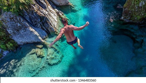 New Zealand. South Island. Jumping from a high bridge to the Blue Pools (Nau Mai)