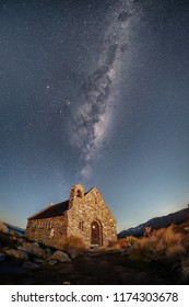 NEW ZEALAND, SOUTH ISLAND, LAKE TEKAPO - JULY 2016: One can see milky way, galaxies, and stars in the night sky. The place is famous tourist destination and travel attraction in New Zealand.