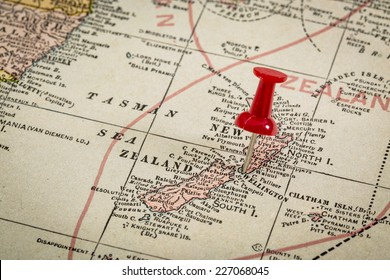 New Zealand and Tasman Sea with a pushpin on Wellington on a vintage 1920s map, selective focus (published in 1926 in New International Atlas of the World))