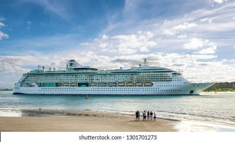 NEW ZEALAND, TAURANGA - JANUARY 2019: A group of unidentified people waves farewell to Radiance of the Seas luxury cruise liner. Radiance of the Seas is a cruise ship owned by Royal Caribbean.