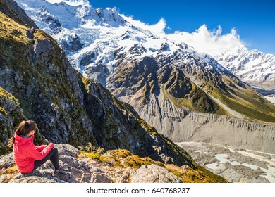 New zealand woman tourist lifestyle hiking in mountains relaxing looking at view of Mt Cook. Alps in South island.
