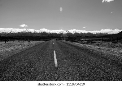 New Zealnd Southern Island road leading to west coat mountain range - black and white