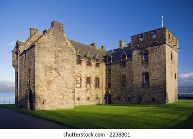 Newark Castle, lit by a low sun, Port Glasgow, Scotland