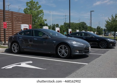 NEWARK, DELAWARE - JULY 20, 2016: Two Tesla vehicles supercharging at the Delaware House Travel Plaza and rest stop.