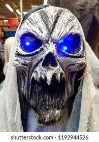 Newark, Delaware, U.S.A - September 29, 2018 - Scary ghost statue with bright blue eyes for Halloween at Lowe's