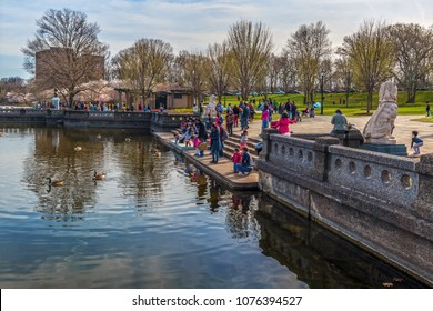 NEWARK, NEW JERSEY - APRIL 21 - Families enjoy feeding the ducks during the  Cherry Blossom Festival in Branch Brook Park on April 21 2018 in Newark New Jersey.