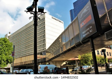 Newark, New Jersey - August 15th 2019: View of the Double Tree Hilton Hotel in Newark, NJ, along with the pedestrian walkway above the busy street from Newark Penn station, opposite.