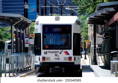 Newark, New Jersey - July 18, 2012: NJ Transit light rail trolley stopped at the Washington Park station