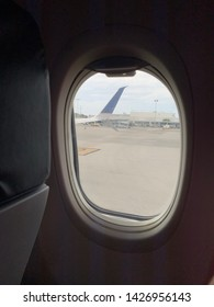 Newark, New Jersey / USA - July 10, 2019: A view of the wing of a united international plane taking of on a gloomy day.