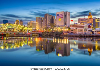 Newark, New Jersey, USA skyline on the Passaic River at dusk.