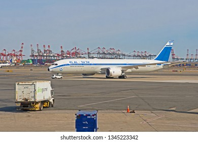 Newark, New Jersey/USA - March 20 2019: a Boeing 787 Dreamliner in the livery of the Israeli company El Al sits on the tarmac at Newark Airport with the cranes of the container port in the background.