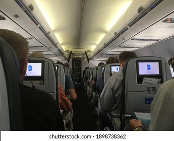 Newark, NJ - 18 August 2018:  Passengers waiting for take off on a United Airline flight at Newark Airport in New Jersey, USA.