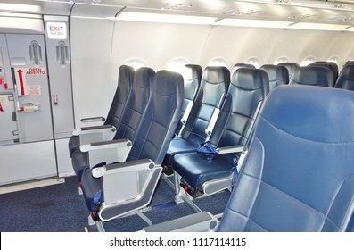 NEWARK, NJ -2 MAR 2018- Inside cabin view of Deluxe Leather seats inside an Airbus A321 airplane from low-cost airline Spirit (NK).