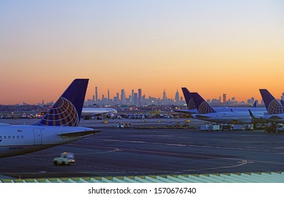 NEWARK, NJ -21 NOV 2019- Sunrise view of an airplane from United Airlines (UA) with the Manhattan skyline in the background at Newark Liberty International Airport (EWR) in New Jersey.