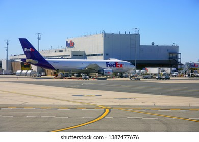 NEWARK, NJ -26 MAR 2019- Airplane from delivery company Federal Express at the Fedex logistics hub at the Newark Liberty International Airport (EWR) near New York City.