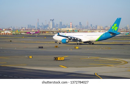 NEWARK, NJ -3 APR 2019- View of an Airbus A330-300 airplane from Irish airline Aer Lingus (EI) at Newark Liberty International Airport (EWR) in New Jersey with the New York skyline.