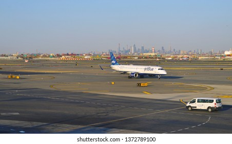 NEWARK, NJ -3 APR 2019- View of a plane from JetBlue (B6) at Newark Liberty International Airport (EWR) in New Jersey with the New York skyline in the background.