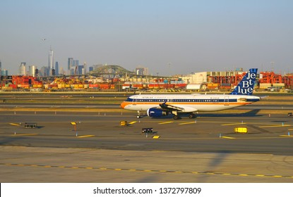 NEWARK, NJ -3 APR 2019- View of a plane from JetBlue (B6) painted in a special pseudo retro livery at Newark Liberty International Airport (EWR) in New Jersey with the New York skyline.