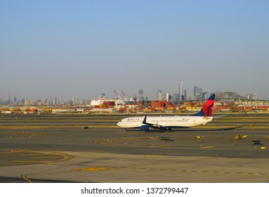 NEWARK, NJ -3 APR 2019- View of a plane from Delta Airlines (DL) at Newark Liberty International Airport (EWR) in New Jersey with the New York skyline in the background.