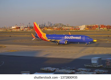 NEWARK, NJ -3 APR 2019- View of a plane from Southwest Airlines (WN) at Newark Liberty International Airport (EWR) in New Jersey with the New York skyline in the background.
