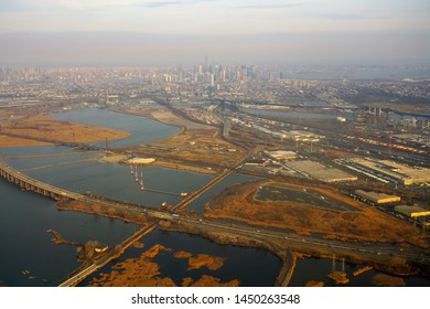 NEWARK, NJ -30 MAR 2019- Aerial view of the Manhattan skyline in New York City seen from an airplane window in New Jersey.