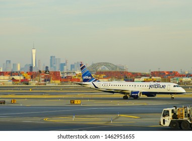 NEWARK, NJ -5 FEB 2019- View of a plane from JetBlue (B6) at Newark Liberty International Airport (EWR) in New Jersey with the New York City Manhattan skyline in the background .